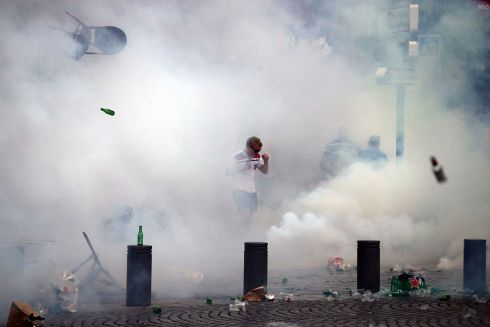 An England fan is surrounded by tear gas during a clash in Marseille ahead of the opening game of Euro 2016.  Photo: Carl Court/Getty Images