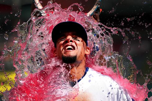 Carlos Gomez of the Texas Rangers is soaked after their win over the Seattle Mariners in August.  Photo: Tom Pennington/Getty Images