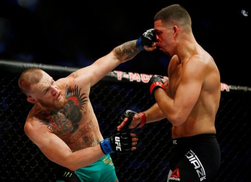 Conor McGregor, left, punches Nate Diaz during their welterweight mixed martial arts bout at UFC 202 in August. McGregor won by majority decision. Photo: Isaac Brekken/AP Photo