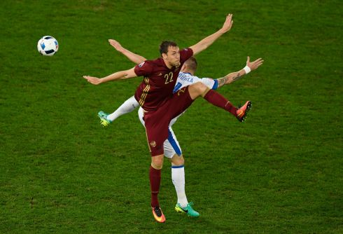 Jan Durica of Slovakia and Artem Dzyuba of Russia batlle for possesion during EURO 2016.  Photo:  Mike Hewitt/Getty Images