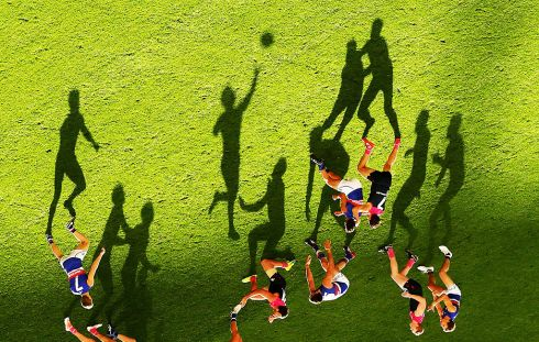 The Western Bulldogs and the Melbourne Demons chasing shadows at the MCG. Photograph: Scott Barbour/Afp