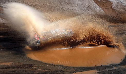Peugeot's Sebastien Loeb makes a splash during Stage 7 of the Dakar 2016 between Uyuni in Bolivia and Salta in Argentina. Photograph: Jorge Saens/Afp