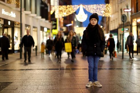 LOST GIRL: Actor Robyn Dempsey (9) represented the 10 million refugee children who have been forced from their homes as a Plan International Ireland campaign aimed to see if shoppers would stop when they saw a child lost on Grafton Street. Photograph: Jason Clarke