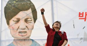 A protester shouts slogans in front of a caricature of Park Geun-Hye during a rally urging  impeachment  on December 7th. Photograph: Jung Yeon-Je/AFP/Gety Images