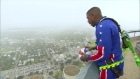 Harlem Globetrotter lands near impossible 178m basketball shot