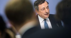 "ECB president Mario Draghi  denied the scaling-back of the asset-purchasing programme was tapering. ""Tapering has not been discussed today,"" he said. Photograph: Frank Rumpenhorst/EPA"