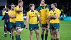 Dejected Australian players after their defeat to England at Twickenham. Photo: Henry Browne/Reuters