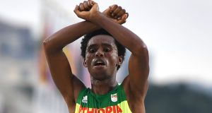 Ethiopia's Feyisa Lilesa crossed his arms at the finish  of the men's marathon in the  Rio 2016 Olympics  as a protest against the Ethiopian government's crackdown on political dissent. Photograph:  Olivier Morin/AFP