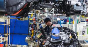 An engine is fitted on the assembly line: Toyota has options around the world if the Burnaston plant ultimately proves unprofitable