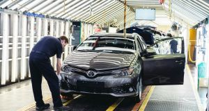 Final checks are made on an  Auris at the Toyota plant in Burnaston, England: Toyota buys parts and hires workers from across the EU