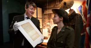 Stuart Cole of Adam's  and Sarah Kinlen with the  Patrick Pearse letter   urging rebels to surrender. Photograph: Cyril Byrne