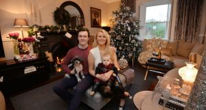 "Éanna, Ciara,  baby Carmen and Harley the dog in their new house: ""It was like living in one of those home makeover shows."" Photograph: Alan Betson"