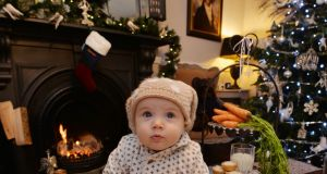 Eight-month-old  Carmen, daughter of Ciara and Éanna in their home in Malahide. Photograph: Alan Betson