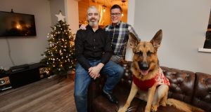 "Buzz O'Neill and Peter Maxwell with their dog Eric in their new home: ""This year all our Christmases have come at once.""  Photograph: Alan Betson"