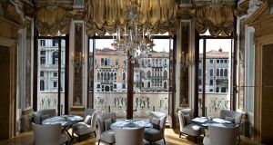 Luxuriate in the deeply cushioning upholstery of this high-back Febo chair, B&B Italia, €3,160 and round Pathos painted frame dining table, €2,735, Maxalto, seen here in the surroundings of the Palazzo Papadopoli, a 16th-century property on Venice's Grand Canal, that is now the Aman Canal Grande Hotel, and where George Clooney and Amal Alamuddin were married. The furniture is available through Mimina.  minimahome.com