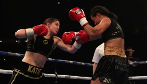 Ireland's Katie Taylor  in action against Viviane Obenauf during their super-featherweight bout at the Manchester Arena. Photograph:  Peter Byrne/PA Wire