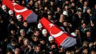 Turkish police officers carry the coffins of comrades during a funeral cerenomy at Istanbul's police headquarters on Sunday. Photograph: Ozan Kose/Getty Images
