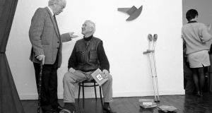 Benedict Kiely and John Montague (seated) at a reception in the Riverrun Gallery,  Dublin, in 1989 to mark the publication of The Figure in the Cave and Other Essays, New Selected Poems and The Rough Field. Photograph: Matt Kavanagh