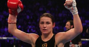 Katie Taylor celebrates beating Viviane Obenauf  at  Manchester Arena on Saturday. Photograph: Peter Byrne/PA