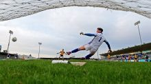 Ulster's Peter Harte puts a penalty past Munster goalkeeper Evan Comerford. Photograph: Donall Farmer/Inpho