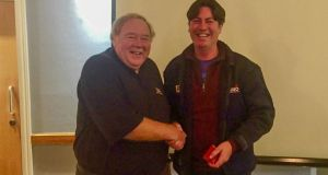 Howth RNLI chairman Russell Rafter (left) presenting station mechanic Ian Sheridan with 30-year service medal. Photograph: Noel Davidson