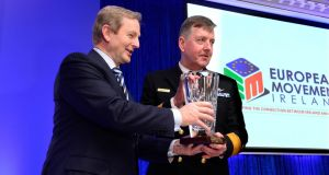 Taoiseach Enda Kenny presenting the European Movement Ireland European of the Year Award to Vice Admiral Mark Mellett. Photograph: Cyril Byrne