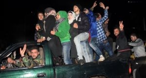 Syrians celebrate in the government-held Mogambo neighbourhood of Aleppo. Photograph: AFP