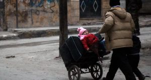 Syrian civilians flee the Sukkari neighbourhood towards safer rebel-held areas in southeastern Aleppo. Photograph: AFP