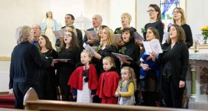 Arlene Harris singing with Barefield Church Choir under the direction of Breda Loughnane with Organist Sarah Ferrigan at Barefield Church this week. Photograph: Eamon Ward