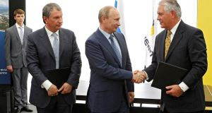 Russia's president Vladimir Putin, Rosneft chief executive Igor Sechin (left) and Exxon Mobil chief  Rex Tillerson take part in a signing ceremony at a Rosneft refinery in the Black Sea town of Tuapse, Russia, on  June 15th, 2012. Photograph:  Sputnik/Kremlin/Mikhail Klimentyev via Reuters