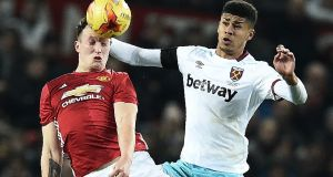 Manchester United's Phil Jones competes with West Ham United's Ashley Fletcher during their recent League Cup quarter-final. Photograph: Getty Images