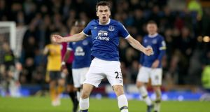 Everton's Seamus Coleman celebrates scoring his side's first goal of the game during the Premier League clash with Arsenal at Goodison Park. Photo: Peter Byrne/PA