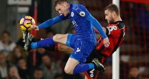 Leicester City's Jamie Vardy in action with Bournemouth's Simon Francis. Photo: Stefan Wermuth/Reuters