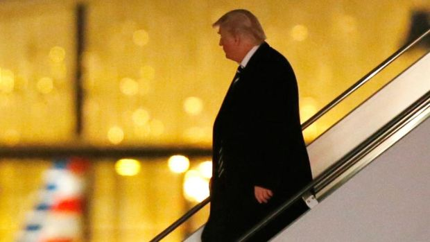 "President-elect Donald Trump walks down the stairs from his plane after returning from Wisconsin to LaGuardia Airport on December 13th. Trump has rejected the findings of the intelligence agencies he will soon oversee as ""ridiculous"", insisting that the hacker may be American, or Chinese, but that ""they have no idea"". Photograph: Kathy Willens/AP"