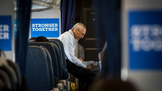 John Podesta, Hillary Clinton's campaign chairman, on board Clinton's campaign plane en route to Raleigh, North Carolina, on September 27th. A phishing email that tricked one of Podesta's aides gave Russian hackers access to 60,000 of his emails; they would be released by WikiLeaks day after day over the last month of the campaign. Photograph: Doug Mills/The New York Times