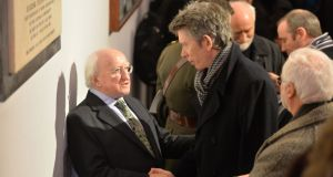 President Michael D Higgins with RTÉ presenter John Kelly at the funeral  of poet John Montague. Photograph: Alan Betson