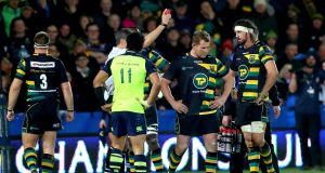 Referee Jérôme Garcès red cards Dylan Hartley of Northampton Saints after he struck Leinster's Seán O'Brien around the head. Photo: James Crombie/Inpho