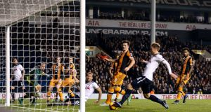 Tottenham Hotspur's Christian Eriksen scores his side's second goal of the game during their Premier League win over Hull City at White Hart Lane, London. Photo: Steven Paston/PA Wire