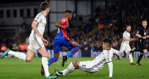 Manchester United's Marcos Rojo lunges in on Wilfried Zaha of Crystal Palace during his side's 2-1 Premier League win at Selhurst Park. Photo: Tony O'Brien/Reuters