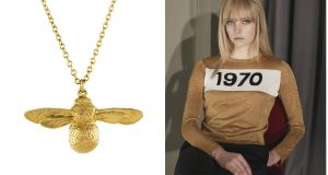 Bumblebee necklace and gold lurex Bella Freud sweater emblazoned with the year 1970