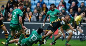 Wasps' Kurtley Beale evades Stacey Ili's tackle to score a try against Connacht. Photograph: Paul Childs/Reuters