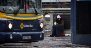 "A homeless person begs in Dublin city centre, above. On Thursday night, co-founder of Home Sweet Home, trade unionist Brendan Ogle, told The Irish Times the group had identified a Nama-managed property in the city centre and planned to stage a ""citizens' intervention in the homelessness crisis"". File photograph: Getty Images"