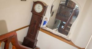 Grandfather Clock at the top of the stairs. Photograph: James Connolly