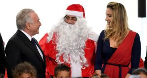 Brazil's president Michel Temer and first lady Marcela Temer at a Christmas celebration in Brasilia on Friday.  Photograph: Evaristo Sa/AFP/Getty Images