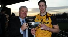 Ulster's Eoin Donnelly is presented with the Interprovincial football cup by GAA President Aogan O'Fearghail. Photograph: Tommy Grealy/Inpho