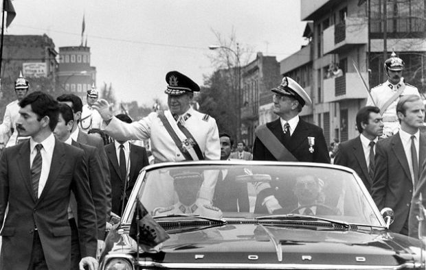 General Augusto Pinochet (l), head of the Chilean military junta, waves from the motorcade 11 September 1973 in Santiago, shortly after his coup that killed President Allende. Photograph: AFP/Getty Images