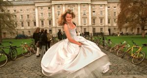 Susan Murray a TCD business student and model wearing a ballgown designed by Brid Nihill during a photocall to publicise the 1999 Trinity Ball. Photograph: Matt Kavanagh.