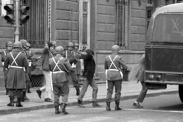 A group of Salvadore Allende's bodyguards are held prisoner by Carabineros, across the street from La Moneda. All of them were killed later. The photograph was taken during the aftermath of the coup d'etat led by Commander of the Army General Augusto Pinochet. Photograph: Horacio Villalobos/Corbis via Getty Images