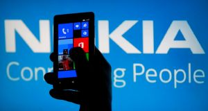 A Nokia Lumia phone: The number employed at  Nokia in Oulu  has halved from  2,500 from 5,000. Photograph: Dado Ruvic/Reuters