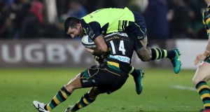 Leinster's Rob Kearney is tackled by Northampton's Ken Pisi during their Champions Cup clash at Franklin's Gardens. Photo: Billy Stickland/Inpho